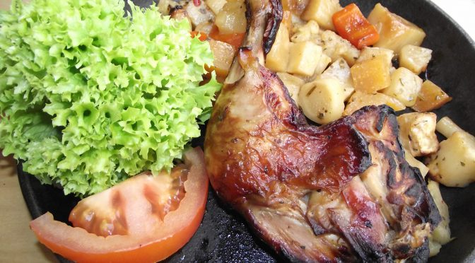 Hühnerbeine auf Wurzelgemüse
